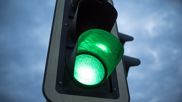 Green Light in front of cloudy sky