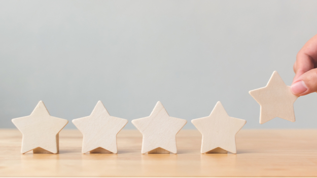 five star cutouts, with hand lifting one up