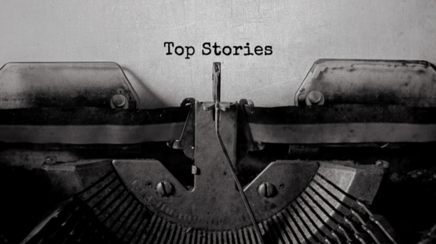 typewriter with paper with words 'Top Stories'