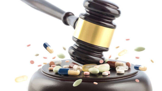 gavel pounding down on pile of pills