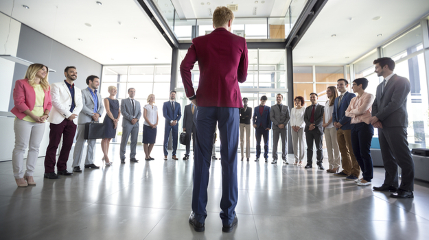 man standing in front of semi-circle of colleagues