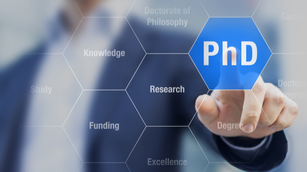 man pressing transparent screen with word Ph.D.