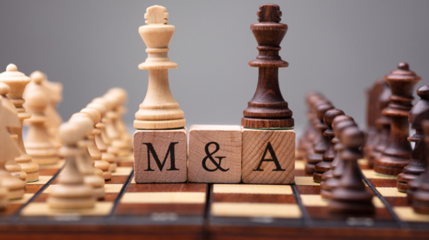 blocks on a chess board with letters 'M&A'