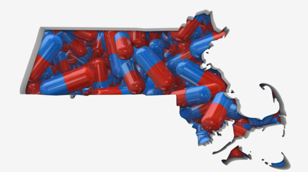 shape of Massachusetts filled in with red and blue pills
