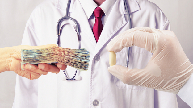 Hand holding stack of cash, and another gloved hand holding pill, in front of doctor