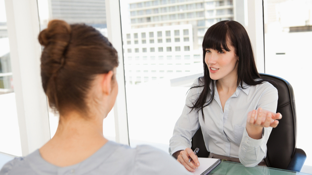 Woman asking interview questions